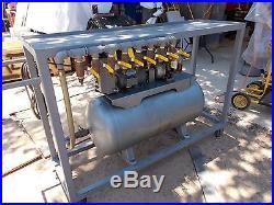 1 USED GAST VACUUM PUMP WITH TANK 1-1/2HP MOTOR #2565u92t t41 and table vacuum